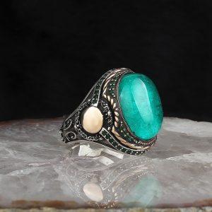 خاتم فضة عيار 925 مرصع بحجر البارايبا بتصميم مميز