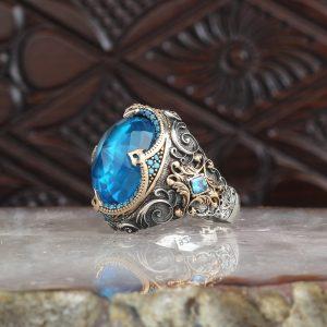 خاتم فضة عيار 925 مرصع بحجر توباز الازرق بتصميم مميز