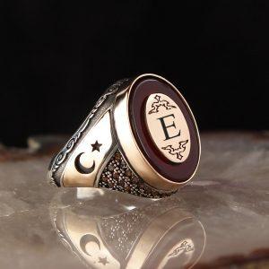 خاتم فضة عيار 925 مرصع بحجر العقيق الاحمر منقوش هلال ونجمة مع كتابة حرف