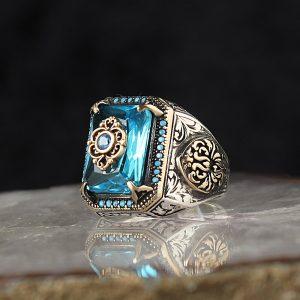 خاتم فضة عيار 925 مرصع بحجر التوباز الازرق بتصميم مميز