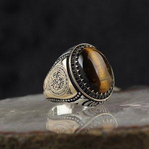 خاتم فضة عيار 925 مرصع بحجر عين النمر مع كتابة (لا إله إلا الله محمد رسول الله) على الجانبي