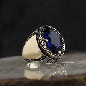 خاتم فضة عيار 925 مرصع بحجر الزيركون الازرق بتصميم مميز