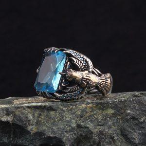 خاتم فضة عيار 925 مرصع بحجر التوباز الازرق بتصميم النسر