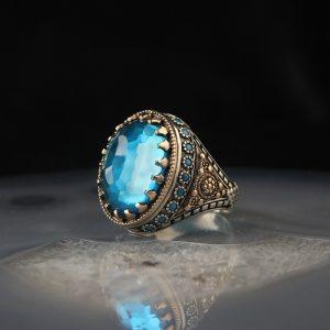 خاتم فضة عيار 925 مرصع بحجر التوباز الازرق بتصميم انيق