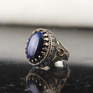خاتم فضة عيار 925 مرصع بحجر عين الهر الازرق بتصميم مميز